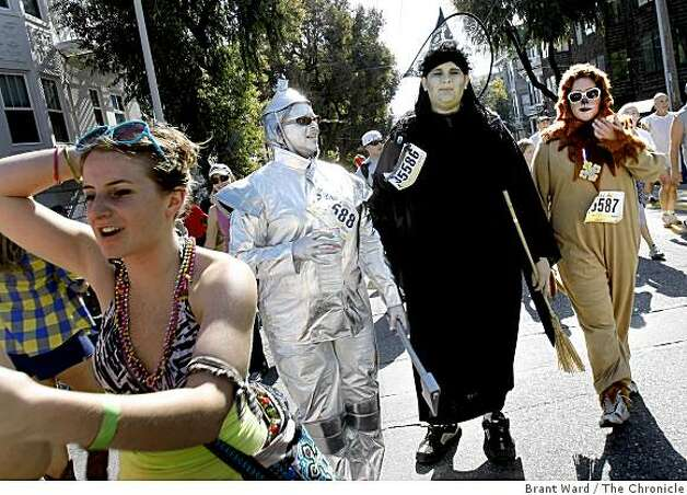 Runners dressed as Wizard of Oz characters agreed their costumes were a bit warm Sunday. The 98th running of the Bay to Breakers in San Francisco, CA featured a police crackdown on public drinking. Photo: Brant Ward, The Chronicle