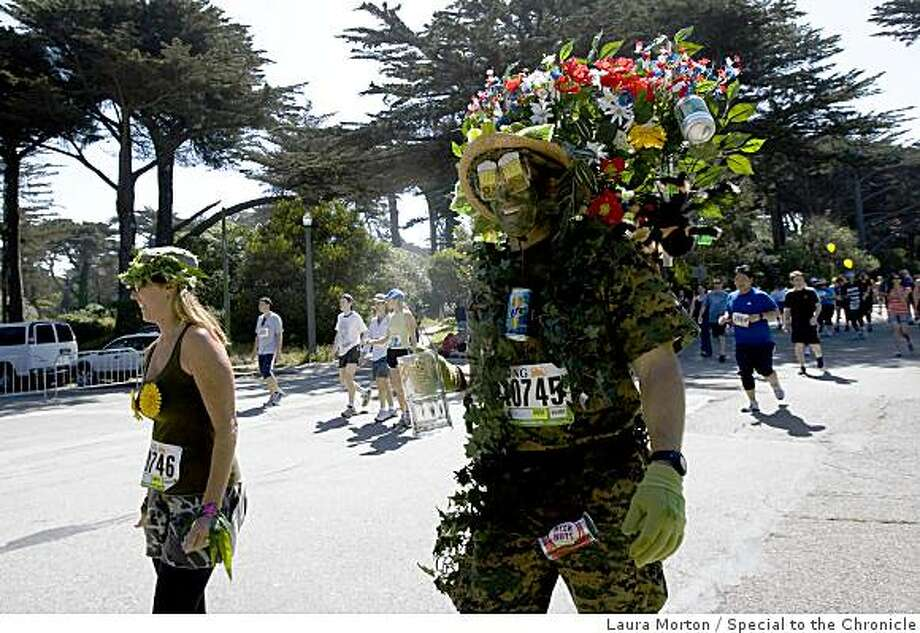 Greg Willard, dressed as a beer garden, head to the finish line during the Bay to Breakers. Photo: Laura Morton, Special To The Chronicle
