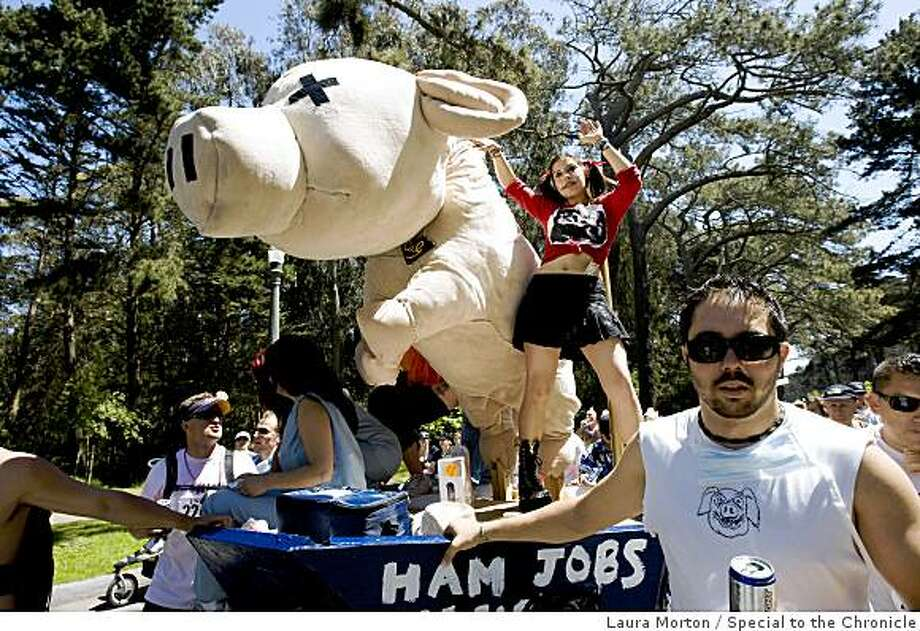 Dolly Olive dances on a swine flu theme float created by the Berkeley Pi Kappa Phi chapter during the Bay to Breakers. Photo: Laura Morton, Special To The Chronicle