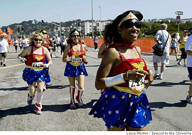 A group dressed in wonder women costumes head toward the finish line during the Bay to Breakers. Photo: Laura Morton, Special To The Chronicle