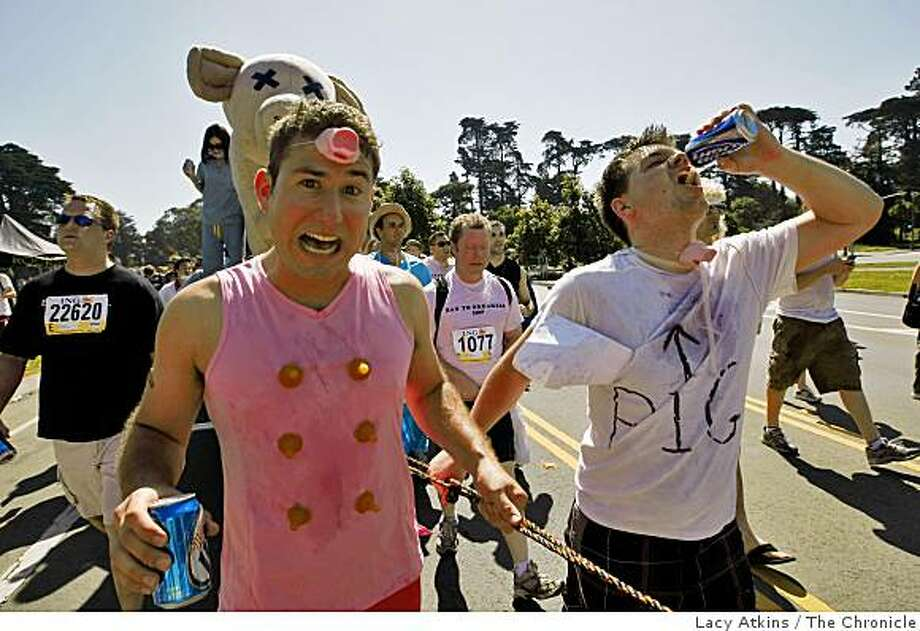 Rob Dernman (left) and Jason Hamilton (right) party as they pull a Swine Flu float in the Bay to Breakers. Photo: Lacy Atkins, The Chronicle