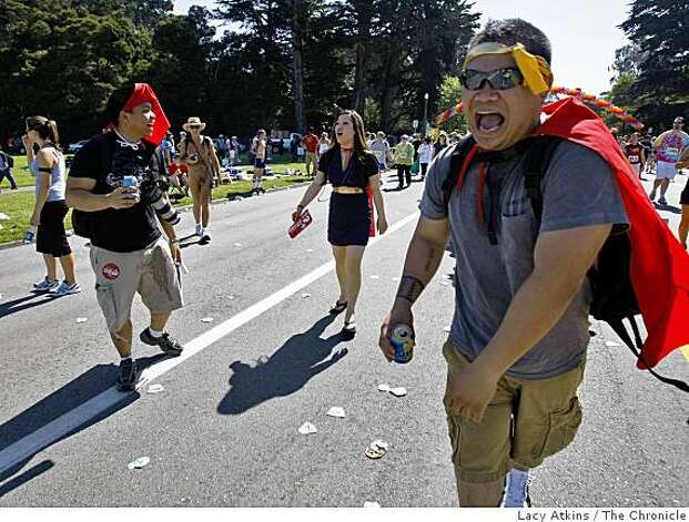 John Michael Cordero (right) laughs after throwing beer on friend Jackson Nicolas ( left) as they walk the Bay to Breakers. Photo: Lacy Atkins, The Chronicle