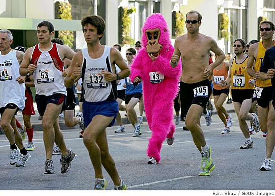 """FILE - Runners, some wearing costumes, take part in the ING Bay to Breakers race May 17, 2009 in San Francisco, California. The 2020 race has been officially cancelled and will instead go """"virtual."""" Photo: Ezra Shaw, Getty Images"""