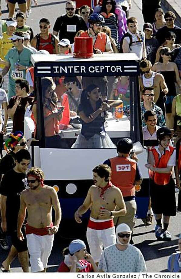 The 98th running of the Bay to Breakers. On hand were the usual costumed runners, floats, and scene. This year's news was the new rules regarding permits for floats and prohibition of kegs, but little enforcement was visible in the the mix. Photo: Carlos Avila Gonzalez, The Chronicle