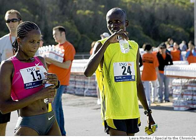 Teyba Erkesso of Ethiopia and Sammy Kitwara of Kenya cool down after running the Bay to Breakers. Erkesso as the top women's finisher and Kitwara the first to finish. Photo: Laura Morton, Special To The Chronicle