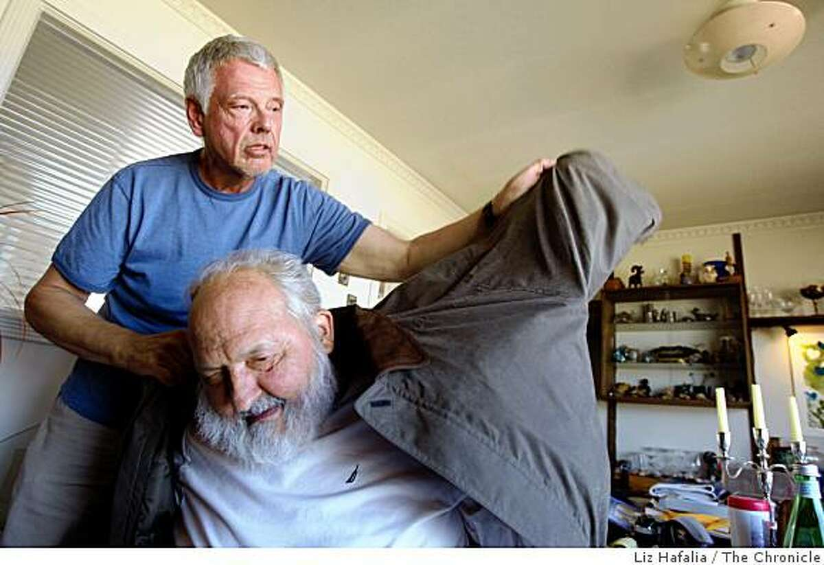 Francis Gates (seated), 81 years old, being helped by partner Charles Stewart as he prepares to go to his yard in San Francisco, Calif., on Wednesday, September 24, 2008. His doctor is neurologist Dr. Charles Cobb, who has been giving him vaccination treatments since removal of his brain tumor. As Gates' tumor has not recurred, Cobb suggests deadly brain tumors are also viruses treatable by vaccination.