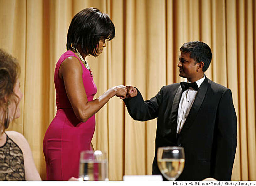 First lady Michelle Obama gives a congratulatory fist bump to an unnamed scholarship awardee during