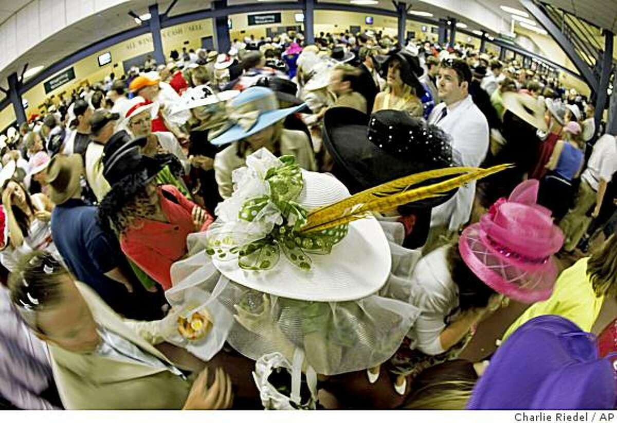 Spectators wait in the concourse for the start of the 135th Kentucky Derby at Churchill Downs Saturday, May 2, 2009, in Louisville, Ky.