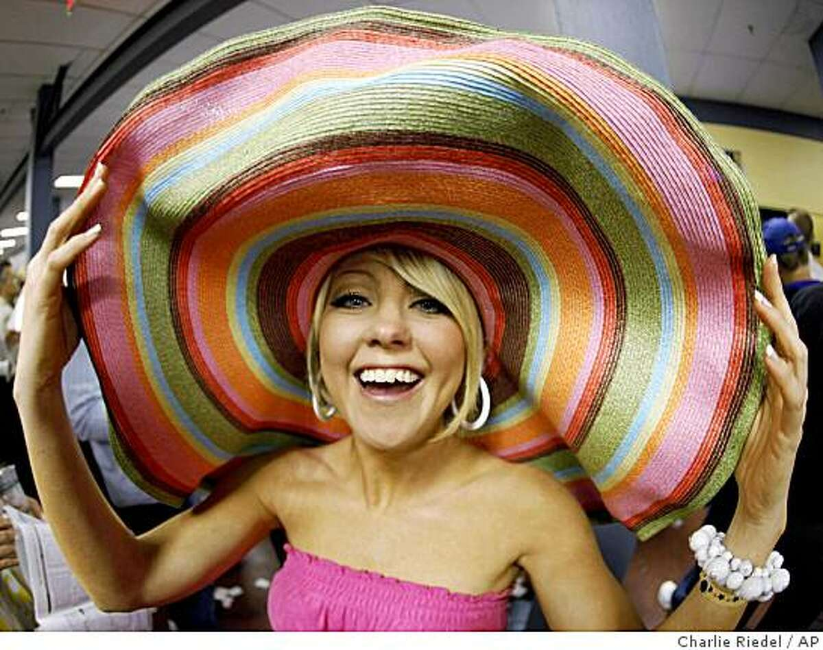 Jennifer Baisden of Columbus, Ohio, shows off her fancy hat at the 135th Kentucky Derby at Churchill Downs Saturday, May 2, 2009, in Louisville, Ky.