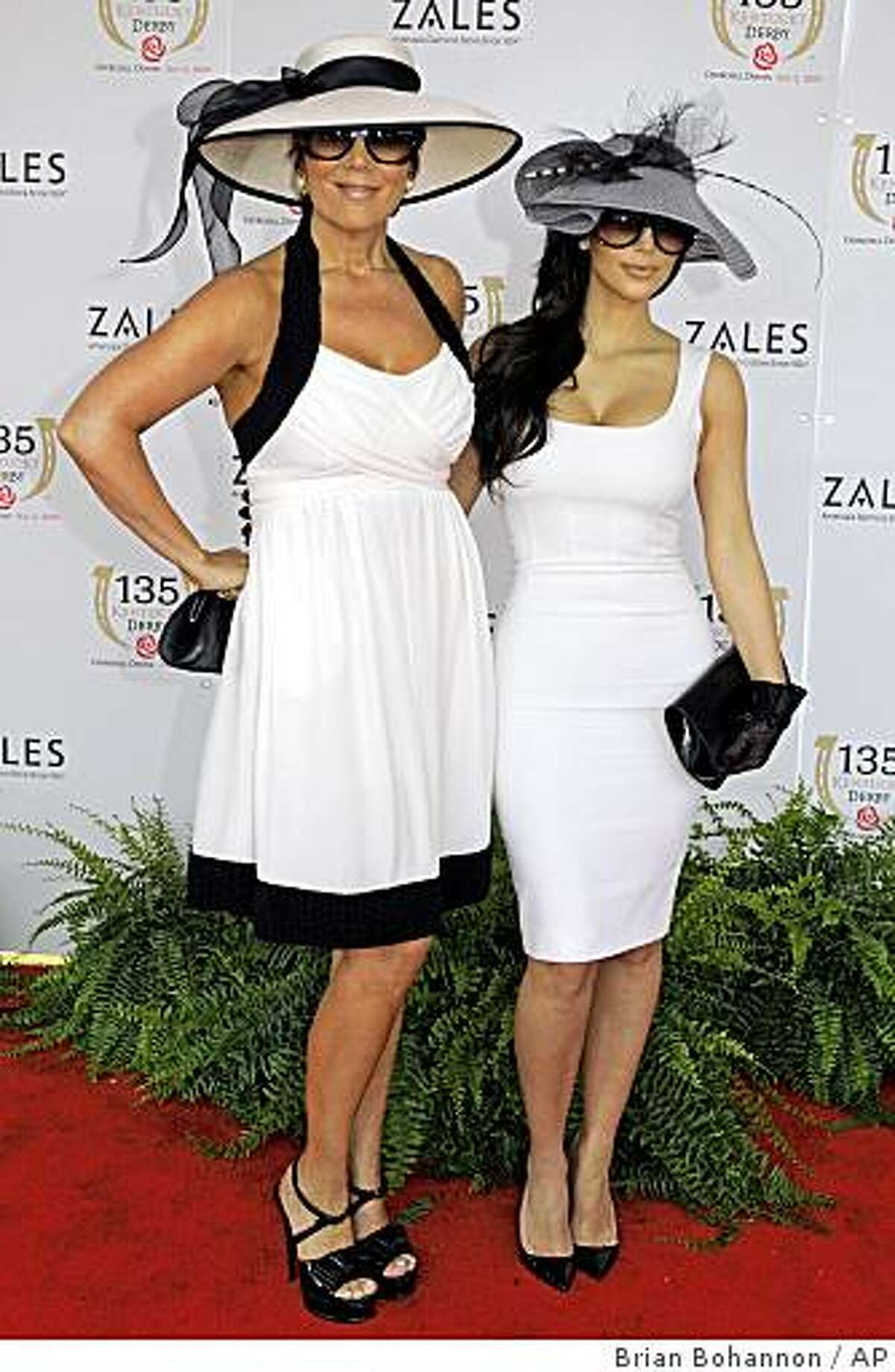 Kim Kardashian, right, poses with her mother Kris Jenner as they arrive at the 135th Kentucky Derby at Churchill Downs Saturday, May 2, 2009, in Louisville, Ky.