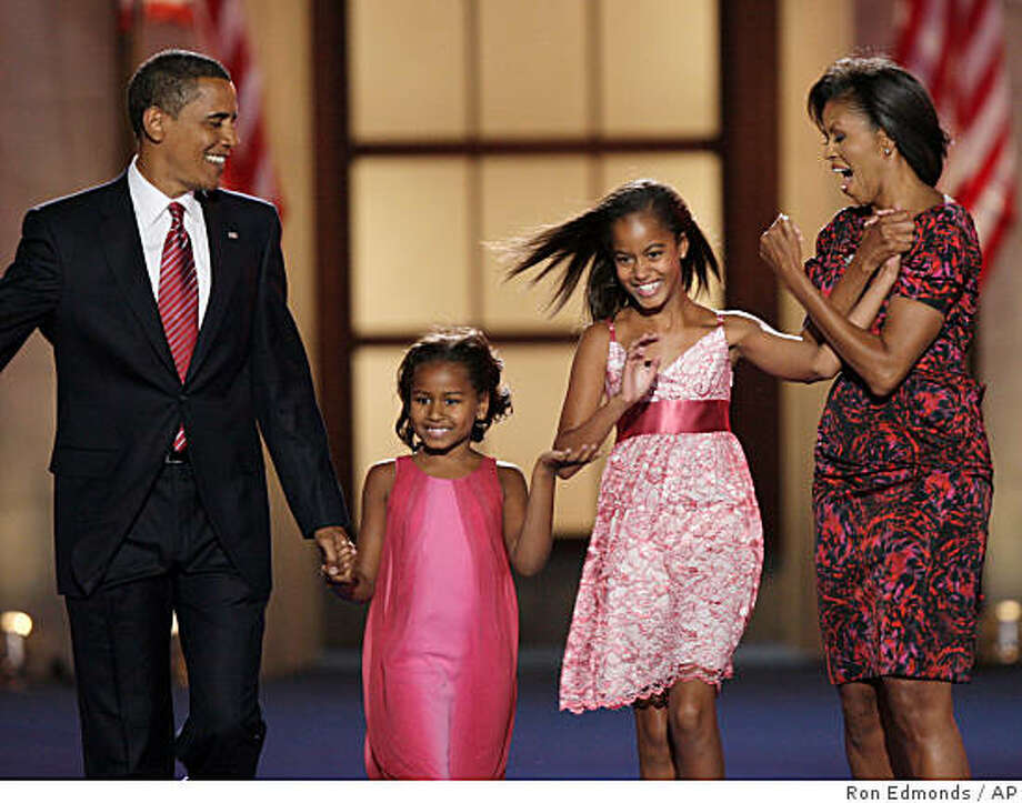 Democratic presidential nominee, Sen. Barack Obama, D-Ill., his wife, Michelle, and daughters Malia, 10, second from right, and Sasha, 7, take the stage after his acceptance speechat the Democratic National Convention in Denver, Thursday, Aug. 28, 2008. Photo: Ron Edmonds, AP