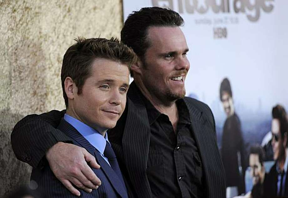 """Kevin Connolly, left, and Kevin Dillon, cast members in the HBO series """"Entourage,"""" pose together at the premiere of the show's seventh season in Los Angeles, Wednesday, June 16, 2010. Photo: Chris Pizzello, AP"""