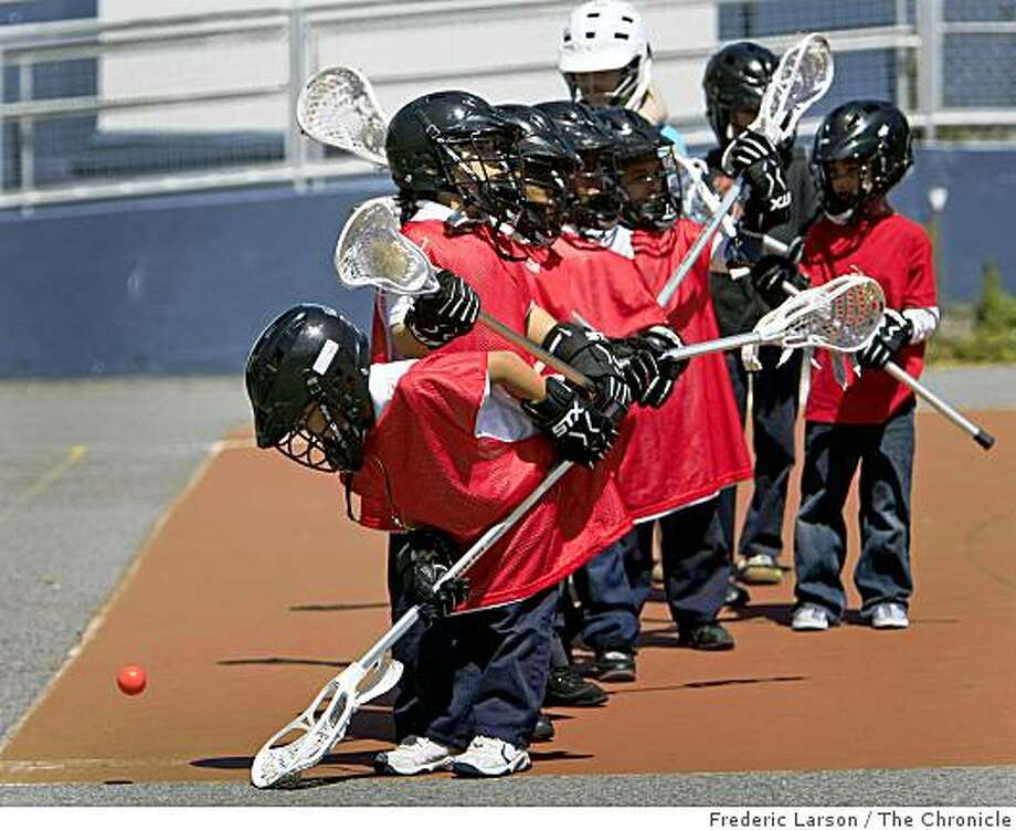 A group of intercity elementary school children are introduced to the game of Lacrosse twice a week at Rosa Parks School in San Francisco on April 14, 2009. Photo: Frederic Larson, The Chronicle