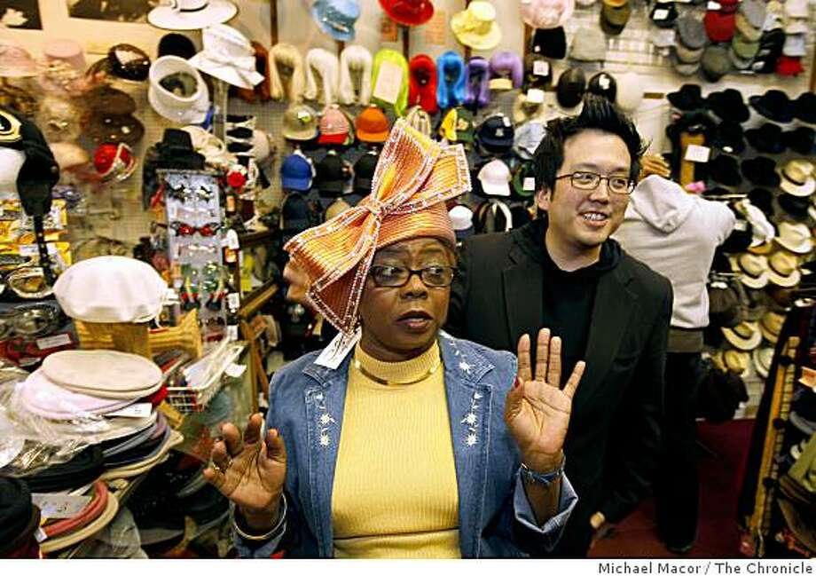 "Brenda Bruner, of Oakland, is helped by Luke Song, owner of ""Mr. Song Millinery"" in Detroit, as she tries on one of his hat designs during a visit to the Berkeley Hat Co., on Friday April 24, 2009, in Berkeley, Calif. Photo: Michael Macor, The Chronicle"