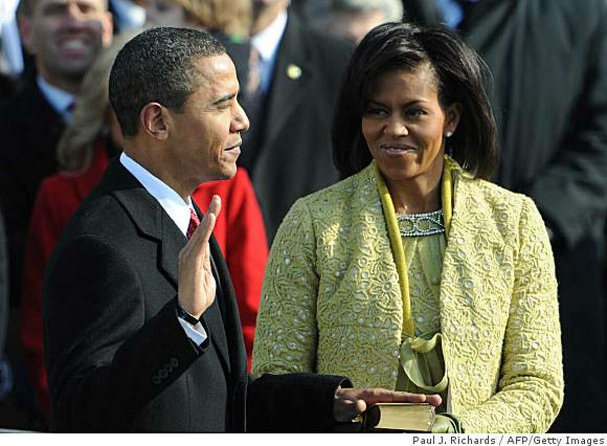 Barack Obama is sworn in as the 44th US president by Supreme Court Chief Justice John Roberts.