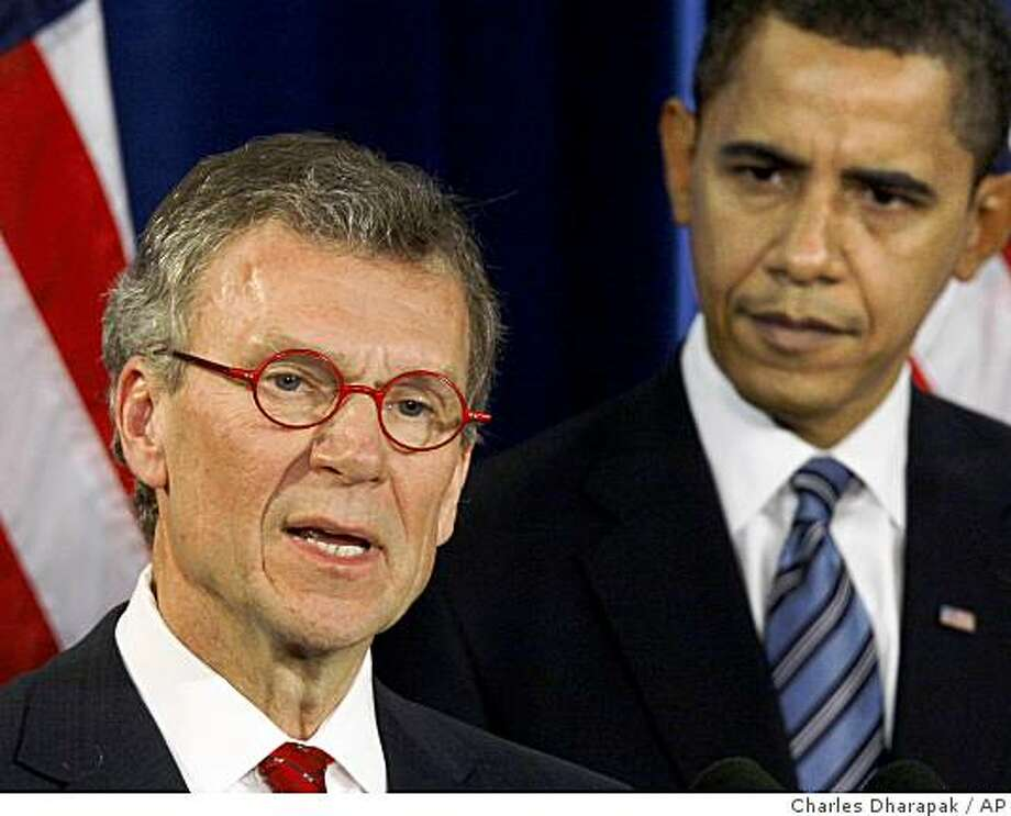 **FILE** In this Dec. 11, 2008 file photo, President-elect Barack Obama, right, stands with Health and Human Services Secretary-designate, former Senate Majority Leader Thomas Daschle, during a news conference in Chicago.  Daschle recently filed amended tax returns to report $128,203 in unpaid taxes and $11,964 in interest, according to a Senate document obtained by The Associated Press. (AP Photo/Charles Dharapak, File) Photo: Charles Dharapak, AP