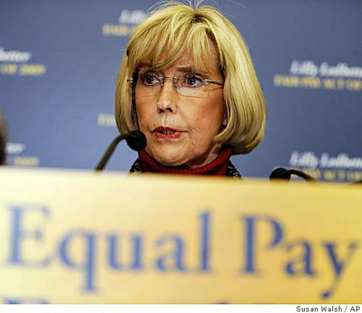 ** FILE ** In this Jan. 22, 2009 file photo. Lilly Ledbetter, an Alabama Goodyear Tire & Rubber Co. worker, speaks during a news conference on Capitol Hill in Washington. Congress sends the White House its first legislation in Barack Obama's presidency, a bill that allows women to sue retroactively for pay and other workplace discrimination that occurred years, even decades in the past. It has been a priority for women's groups seeking to narrow the wage gap between men and women. More than four decades after the 1964 Civil Right Act banned wage disparity based gender race, women still receive only about 78 cents for every dollar earned by me doing the same work. (AP Photo/Susan Walsh, File)