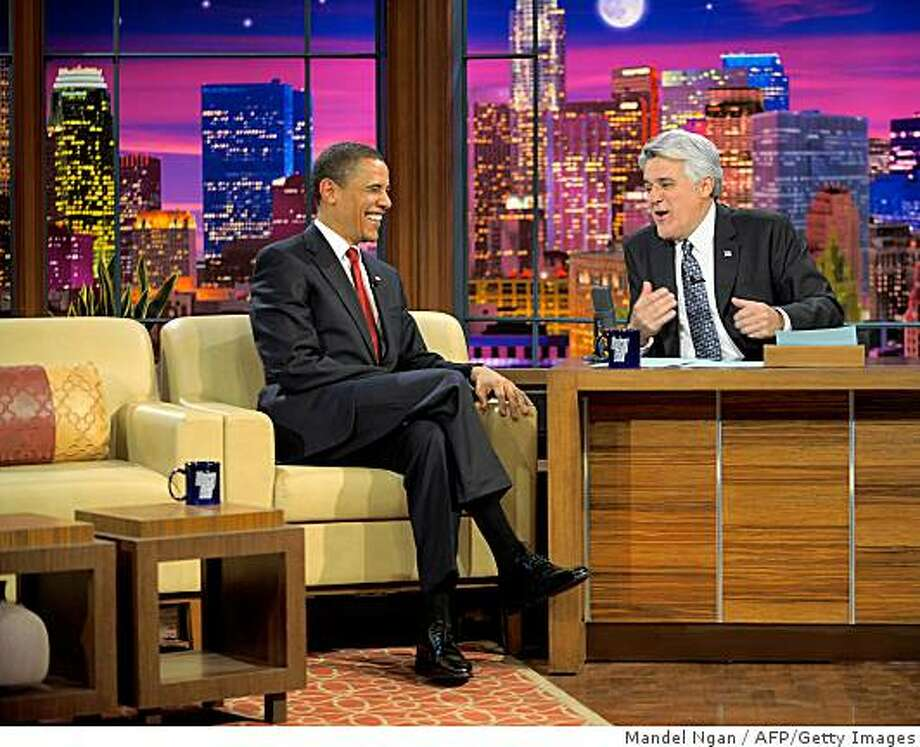 "US President Barack Obama is seen with host Jay Leno during a taping of ""The Tonight Show"" at NBC studios in Burbank, California. Obama has appeared on the late night comedy shows before as a candidate, but NBC said this will be the first time a serving president has been on ""The Tonight Show.""    The long-running show, previously hosted by Johnny Carson, is an entertainment institution in the United States that features Leno's comedy routines, a live band and celebrity interviews.  AFP PHOTO/Mandel NGAN (Photo credit should read MANDEL NGAN/AFP/Getty Images) Photo: Mandel Ngan, AFP/Getty Images"