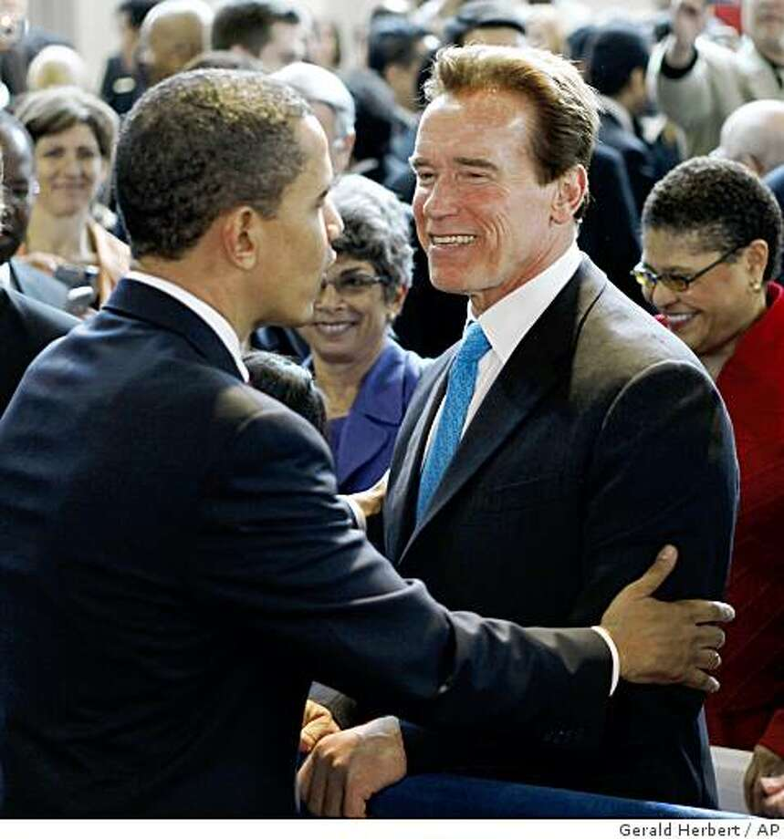President Barack Obama greets California Gov. Arnold Schwarzenegger after speaking at a town hall meeting at the Miguel Contreras Learning Complex in Los Angeles, Thursday, March 19, 2009. (AP Photo/Gerald Herbert) Photo: Gerald Herbert, AP