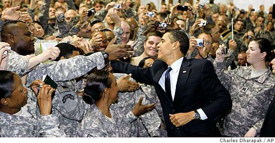 President Barack Obama greets military personnel at Camp Victory in Baghdad, Tuesday, April 7, 2009. (AP Photo/Charles Dharapak) Photo: Charles Dharapak, AP