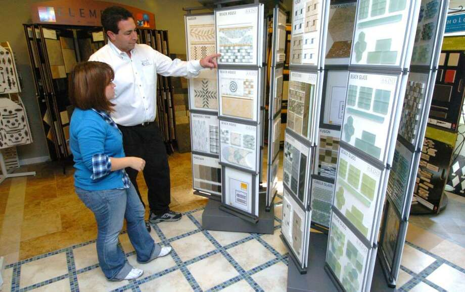 Barry Miller and Rachel Peterson, from The Brushe's End in Danbury, CT, talk about a cutomers project at their showroom Friday Oct. 23, 2009. Photo: Chris Ware / The News-Times