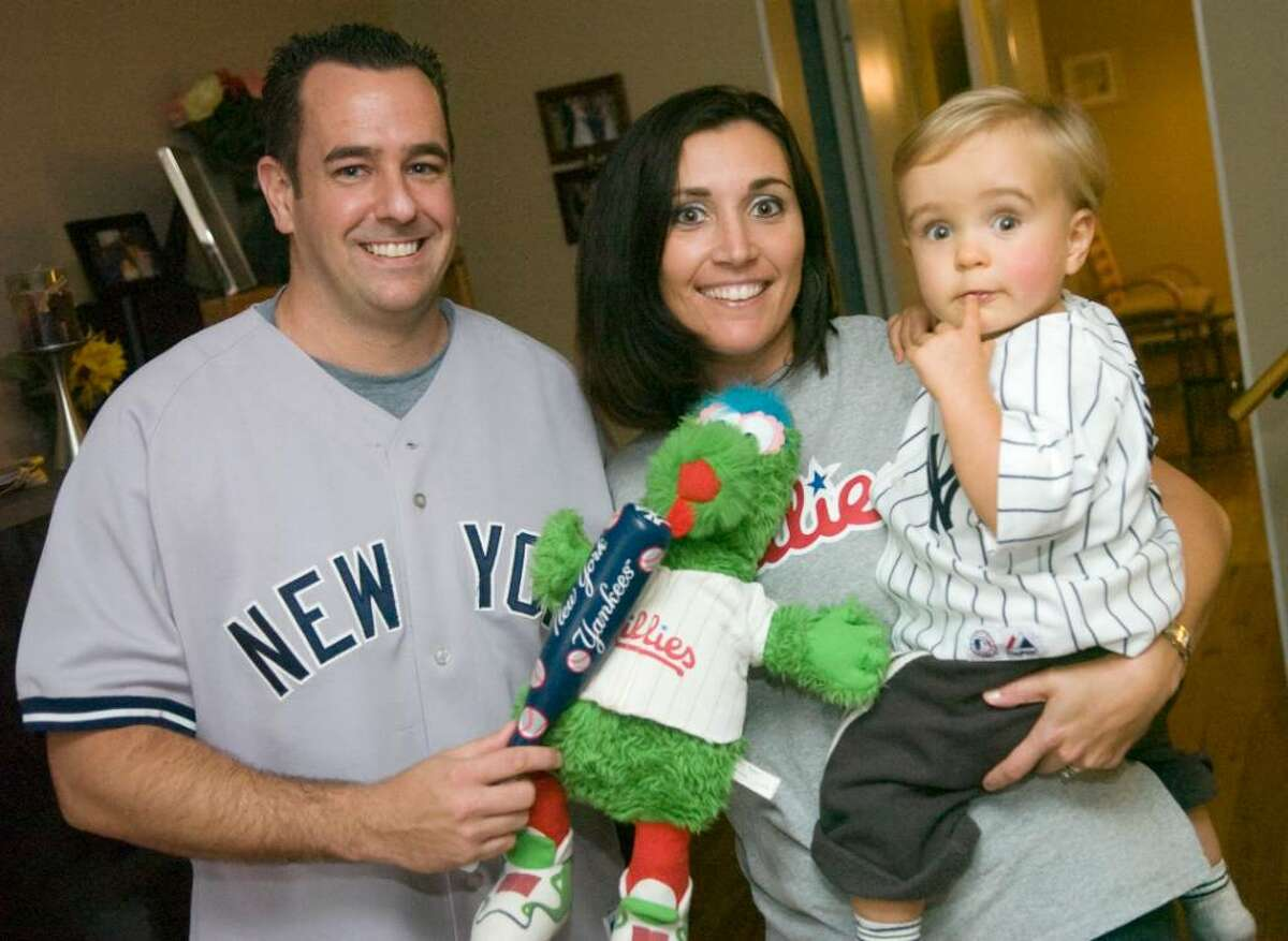 Mike McGrath, his wife Kim McGrath and their son Aiden McGrath, 18-months, pose in their home in Stamford, Conn. on Monday, Oct. 26, 2009.