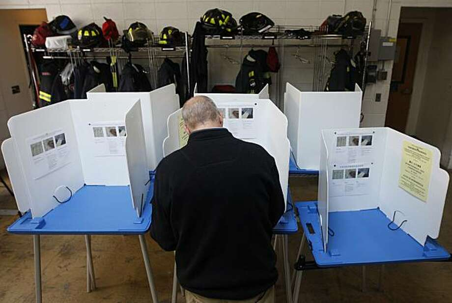 Eric Haesloop casts his ballot in a polling place at Fire Station No. 3 on Russell Street in Berkeley on Tuesday. Photo: Paul Chinn, The Chronicle