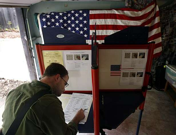 Seth Kauppinen marks his ballot at a polling place on Eunice Street in Berkeley on Tuesday. Photo: Paul Chinn, The Chronicle