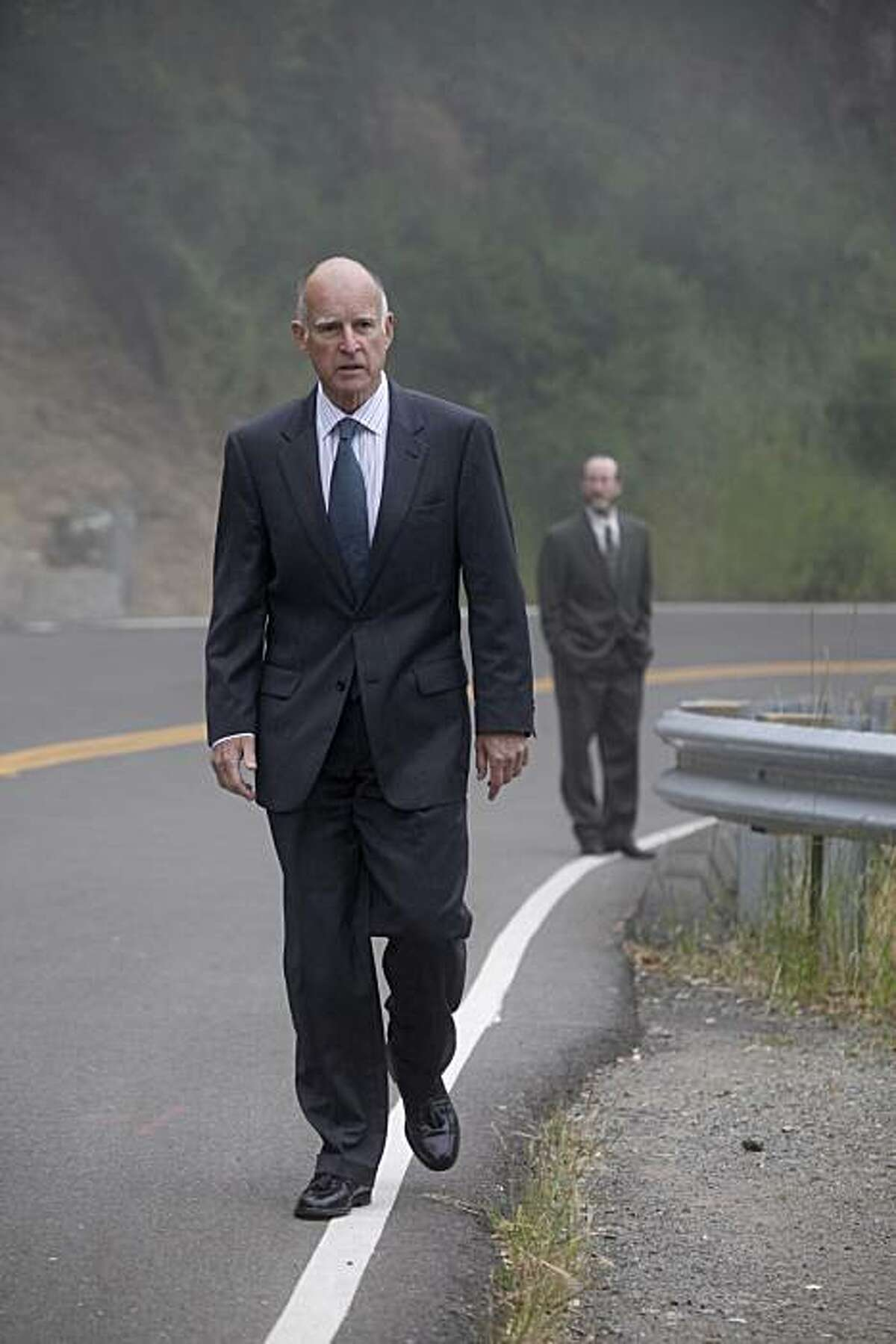 Joined by his campaign manager, Steven Glazer, California Attorney General Jerry Brown walks back to his Oakland hills home after voting in the primary election at Oakland Fire House No. 6 on Tuesday.