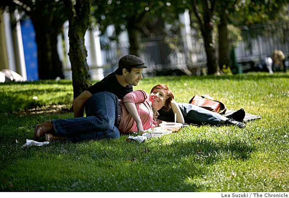 Wendy Taylor (right) of San Francisco and Benoit Dherin (left) of France share the lunch hour together in the sun on the lawn at Yerba Buena Gardens on Monday, September 8, 2008. Photo: Lea Suzuki, The Chronicle