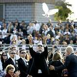 Raymond Courtemanche, Garcia's stepfather who raised him, released a dove as the ceremony ended. Several thousand gathered at Armijo High School in Fairfield for a memorial to slain Fairfield councilman Matt Garcia Tuesday, September 9, 2008.
