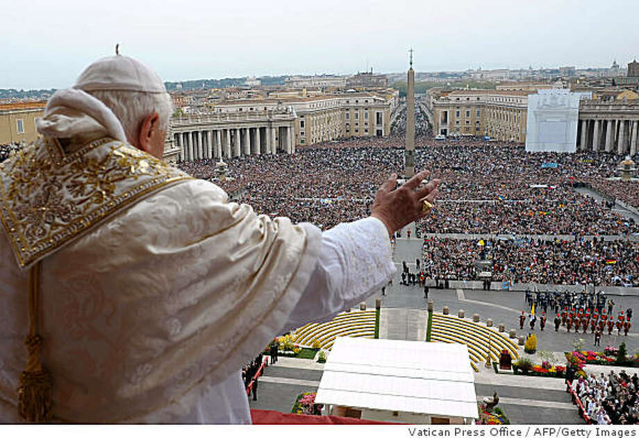 """CORRECTION BYLINE - RESTRICTED TO EDITORIAL USEThis handout picture released by the Vatican Press Office shows Pope Benedict XVI delivering the traditional """"Urbi et Orbi"""" (To the City and the World) Easter message from the central loggia of St Peter's Basilica on April 12, 2009 at the Vatican.    AFP PHOTO/ OSSERVATORE ROMANO (Photo credit should read HO/AFP/Getty Images) Photo: Vatican Press Office, AFP/Getty Images"""
