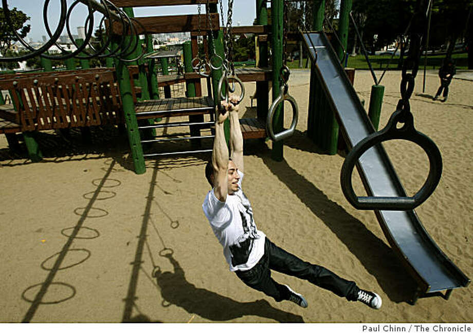 Josh Nielsen swings across the play structure at the Dolores Park playground in San Francisco, Calif., on Tuesday, March 31, 2009. Photo: Paul Chinn, The Chronicle
