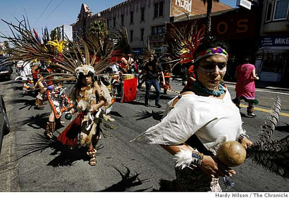"Performers in the dance group ""Xitalli"" dance down Mission Street in San Francisco, Calif., during a parade for civil rights leader Cesar Chavez on Saturday, April 4, 2009. Photo: Hardy Wilson, The Chronicle"