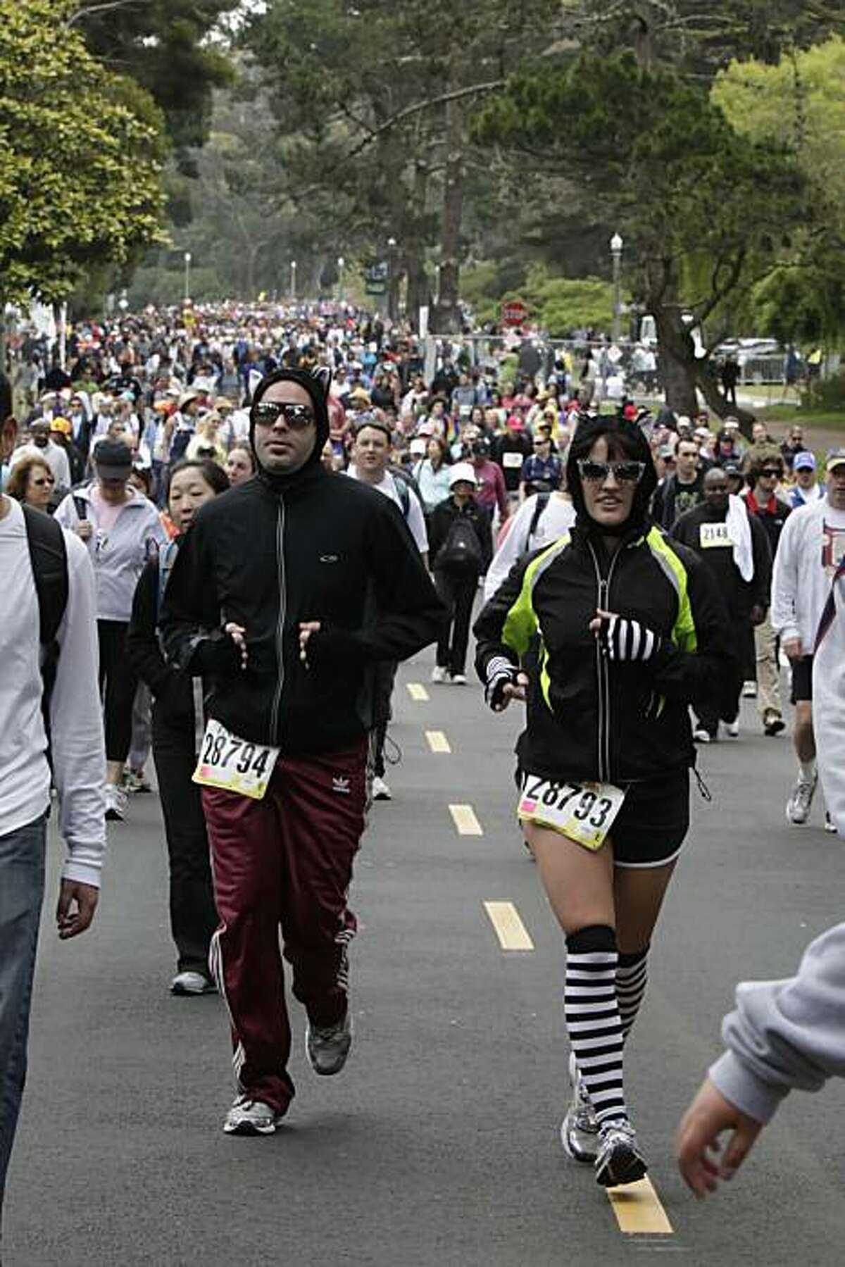 Dan and Michelle Catts run along John F. Kennedy Drive during Bay to Breakers in San Francisco on Sunday.