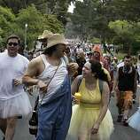 Joseph Martinez II of Palo Alto and Maya Steward of Novato share a laugh as they make their way through Golden Gate Park during Bay to Breakers in San Francisco on Sunday.