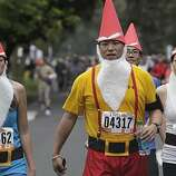 Lisa Rattivat, Ed Lin, Takuya Idehara and Lily Chang, all from Los Angeles, make their way through Golden Gate Park during Bay to Breakers in San Francisco on Sunday.