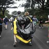 (Left to right) David and Ellen Beaulieu  of El Cerrito ran as an oil slick during the 2010 Bay to Breakers in San Francisco, Calif. on Sunday May 16, 2010.