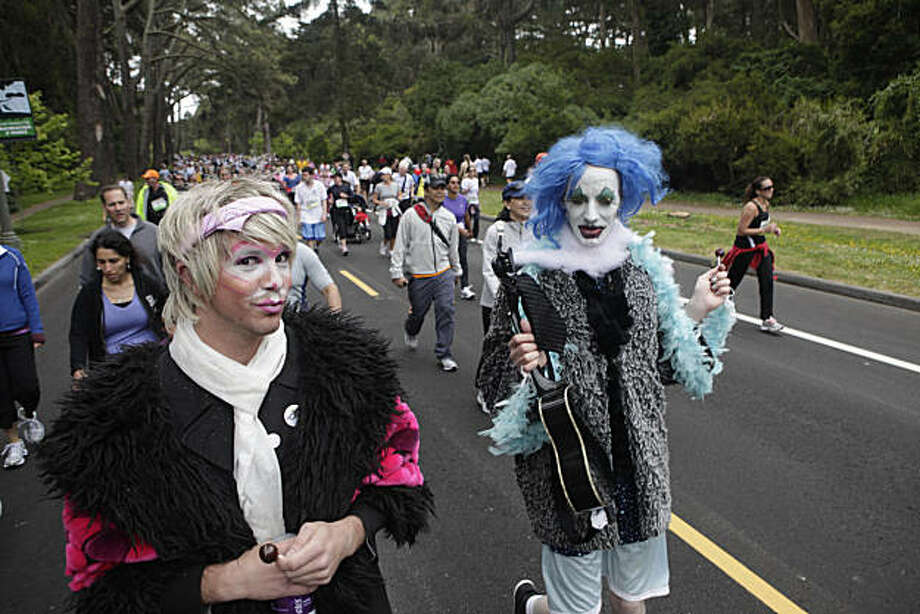 "(Left to right) Christopher Ray and Sahki ""Miz Broken Disco Ball"" Chata, both of San Francisco, make their way through Golden Gate Park with other runners during the 2010 Bay to Breakers in San Francisco, Calif. on Sunday May 16, 2010. Photo: Lea Suzuki, The Chronicle"
