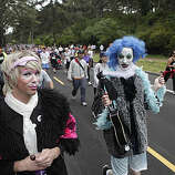 "(Left to right) Christopher Ray and Sahki ""Miz Broken Disco Ball"" Chata, both of San Francisco, make their way through Golden Gate Park with other runners during the 2010 Bay to Breakers in San Francisco, Calif. on Sunday May 16, 2010."