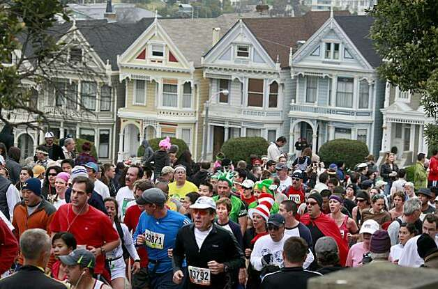 Runners ran past the row of Victorians at Alamo Park. Thousands took place in the 99th annual ING Bay to Breakers event  Sunday morning May 16, 2010 in San Francisco, Calif. Photo: Brant Ward, The Chronicle