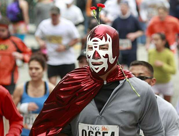 A masked and caped runner added a flower to his costume. Thousands took place in the 99th annual ING Bay to Breakers event  Sunday morning May 16, 2010 in San Francisco, Calif. Photo: Brant Ward, The Chronicle