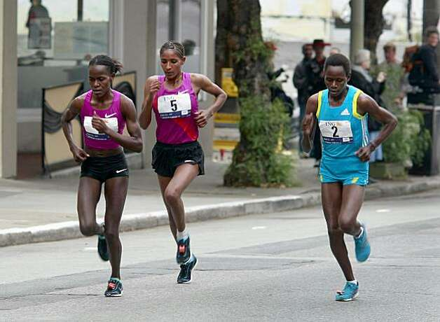 The elite women runners took the corner onto Hayes Street as they began the climb. Thousands took place in the 99th annual ING Bay to Breakers event  Sunday morning May 16, 2010 in San Francisco, Calif. Photo: Brant Ward, The Chronicle