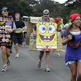 (Left to right) Larry Smith of Newport Beach and Brian Baird of Novato race in the 2010 Bay to Breakers in San Francisco, Calif. on Sunday May 16, 2010.