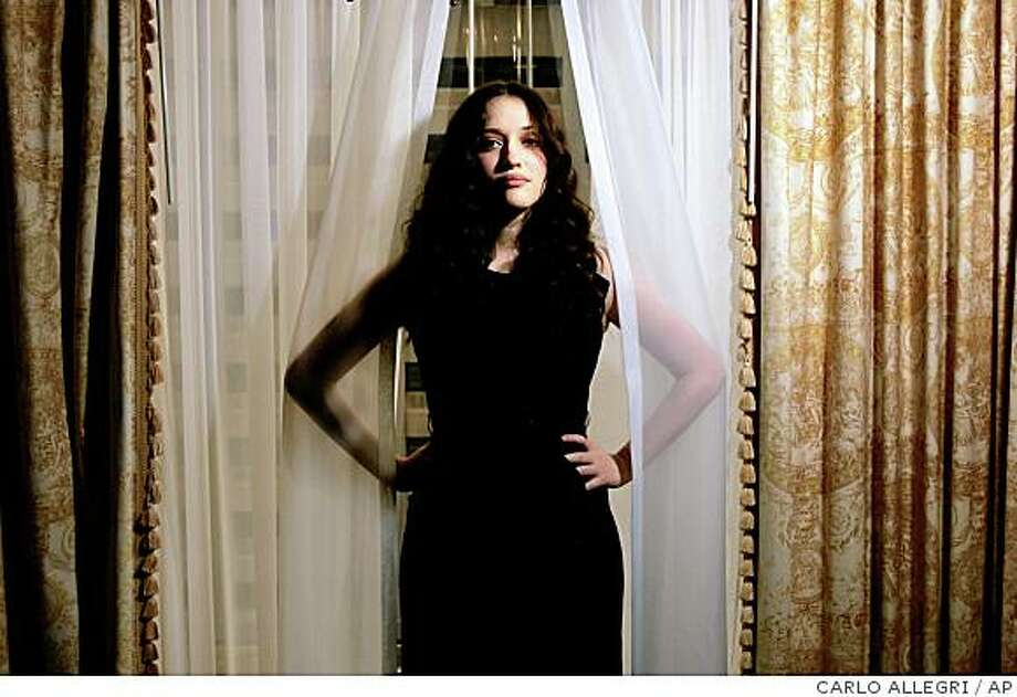 "Actress Kat Dennings poses for a portrait while promoting her movie ""Nick and Nora's Infinante Playlist"" in Toronto, Canada during the International Film Festival Saturday Sept. 6, 2008. (AP Photo/Carlo Allegri) Photo: CARLO ALLEGRI, AP"