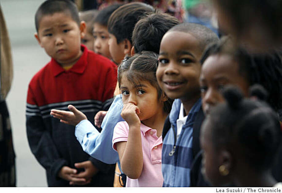 Montessori kindergarteners Chelsey Cruz (center with hand to her face) and Tarrance Ricks (to right of Chelsey) listen to Montessori teacher Meghan Burgess on the first day of school at Dr. William L. Cobb Elementary. Children at Dr. William L. Cobb Elementary start the new school year, with the first Montessori kindergarten opening in the district in San Francisco, Calif. on Monday, August 25, 2008. The Montessori program was first started at Dr. William L. Cobb Elementary in January of 2005, was expanded in 2006 with the addition of another class, but this is the first year that they will have a kindergarten class. In one week, they will be opening their third Montessori classroom with new students. Photo: Lea Suzuki, The Chronicle