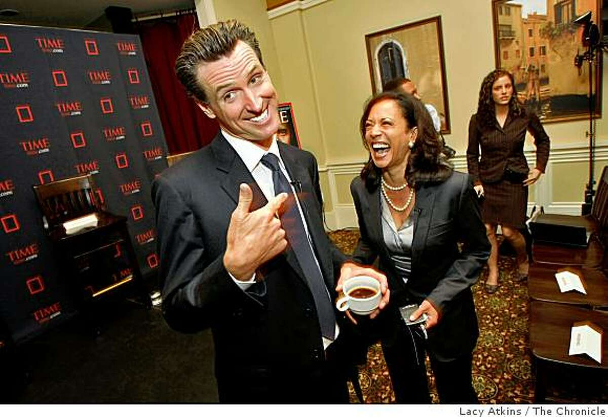 Mayor Gavin Newsom and Kamala Harris laugh as they meet other up and coming young political people at the Time magazine breakfast as part of the Democratic National Convention, Tuesday Aug.26, 2008, in Denver, Colorado.