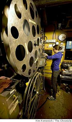 "Projectionist Christina Genualdi threads ""The Wrestler"" before the  6:30 p.m. performance at theParkway Speakeasy Theater in Oakland, Calif., on Thursday, Mar. 19, 2009. Photo: Kim Komenich, The Chronicle"