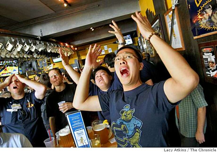 Craig Zanoli ( left) Dave Buck, Ryan Mascarinas and Andy Li reacts as they watched the Cal Bears in the  first round of the NCAA Tournament, Thursday March 19, 2009, at the Bear's Lair restauant and bar, in Berkeley, Calif. Photo: Lacy Atkins, The Chronicle