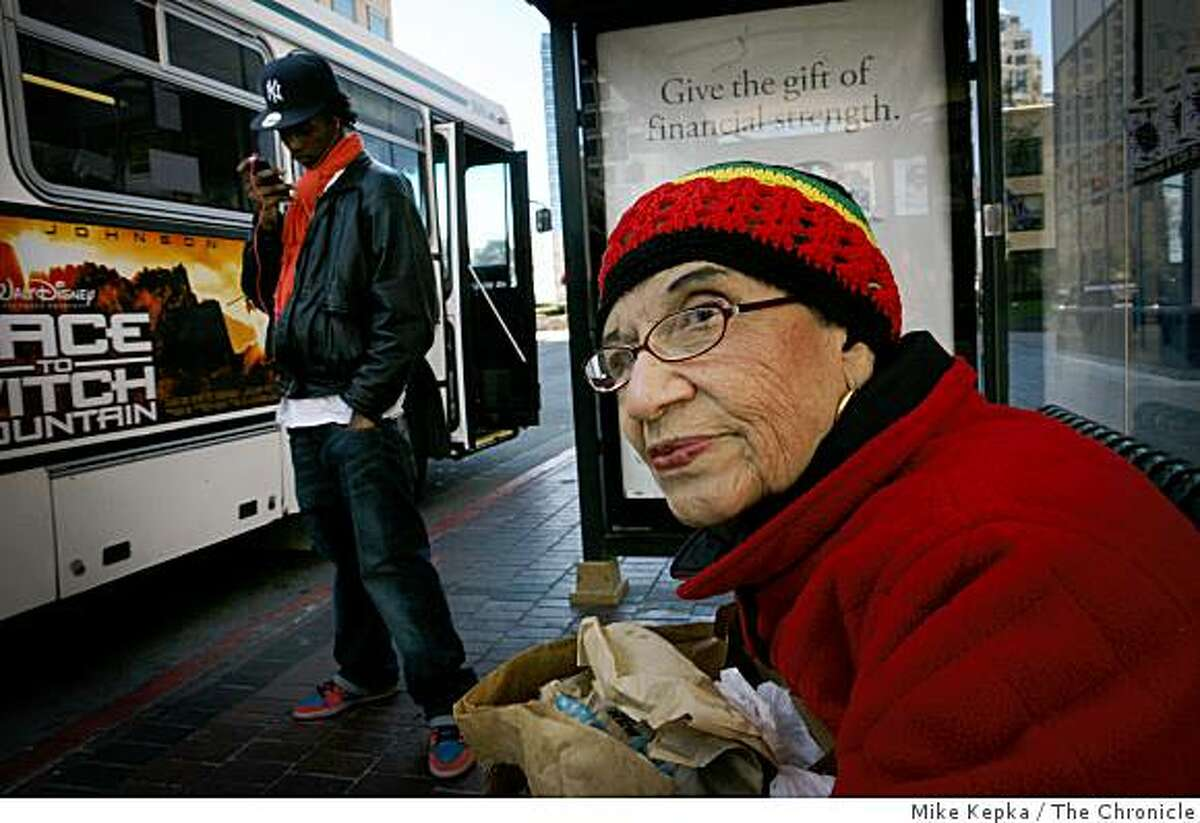 Lorena Corbett, 80, (r) waits for her usual AC Transit bus at 12th and Broadway on Monday March 9, 2009 in Oakland, Calif.